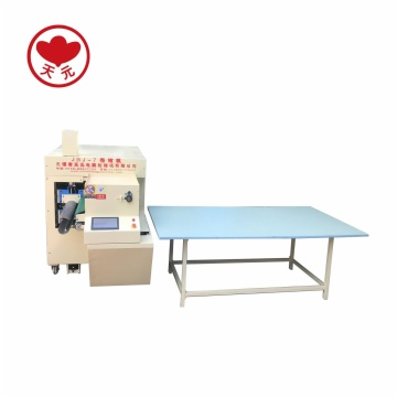 JBJ-7 QUILT/PILLOW COILING AND ROLLING MACHINE